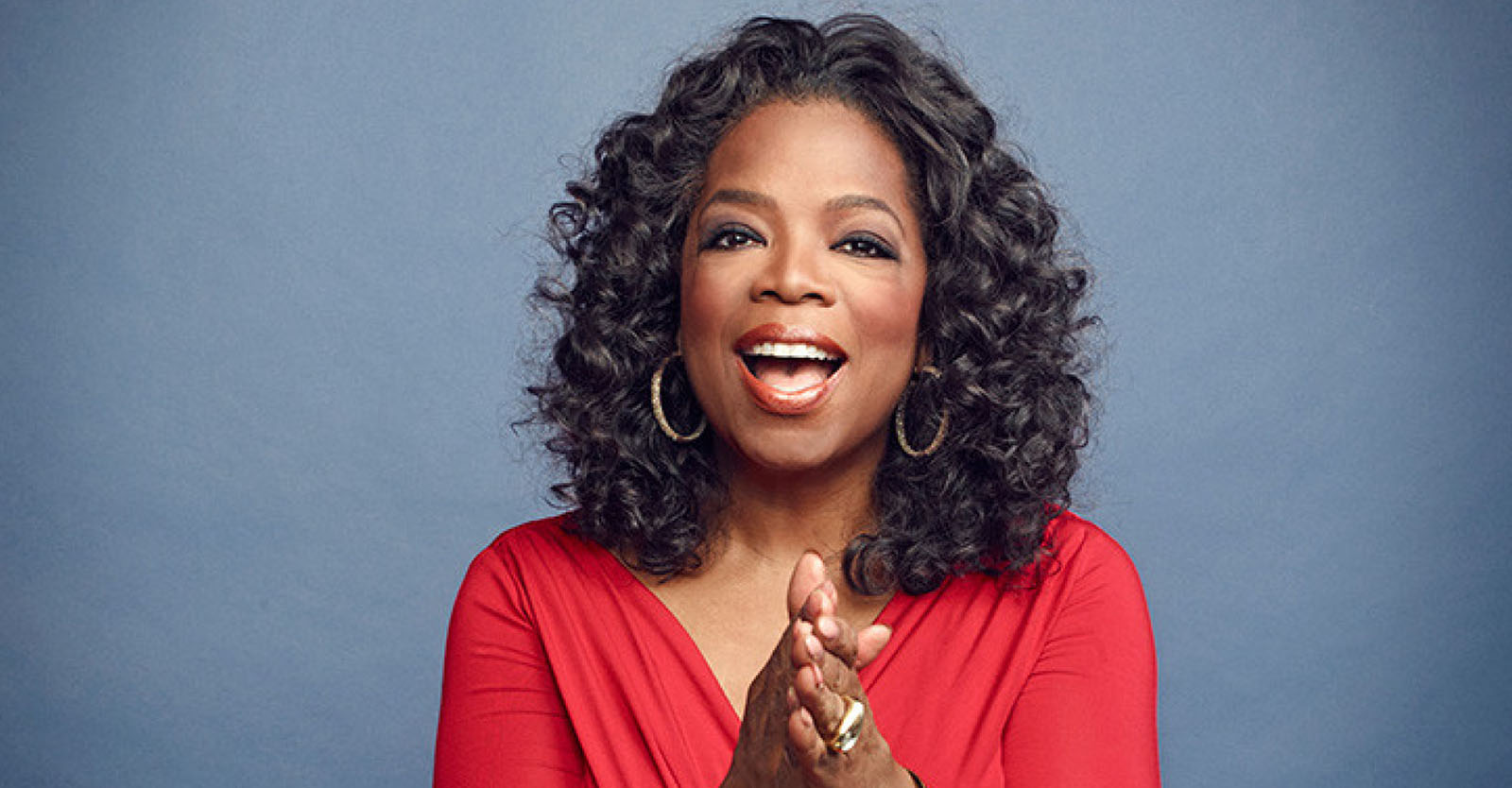 Oprah Winfrey red dress clapping smiling